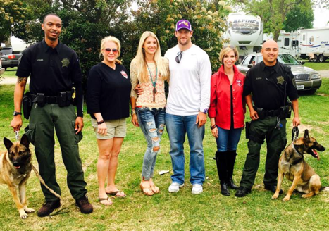 Deputy Jones, K9 Hawk, K9s4COPS Founder Kristi Schiller, Brian and Jayme Robiso, K9s4COPS Executive Director Roseann Rogers, Deputy Zuniga and K9 Chapo